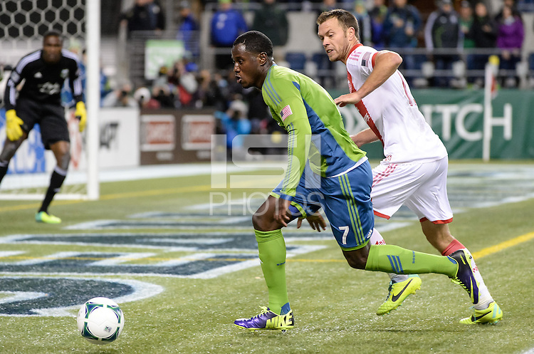 November, 2013: CenturyLink Field, Seattle, Washington: Seattle Sounders FC forward Eddie Johnson (7) pursues the ball against Portland Timbers midfielder Will Johnson (4)  as the Portland Timbers defeat  the Seattle Sounders FC 2-1 in the Major League Soccer Playoffs semifinals Round.