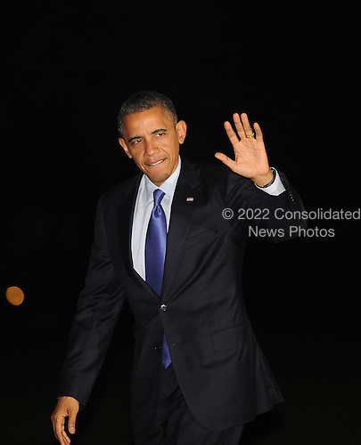 United States President Barack Obama waves as he walks on the South Lawn of the White House on October 17, 2012 in Washington, DC. Obama was returning from Iowa and Ohio after speaking at campaign rallies.  .Credit: Olivier Douliery / Pool via CNP
