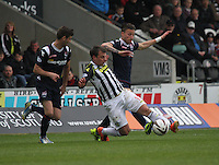 Paul McGowan (centre) and Melvin De Leeuw go for the ball watched by Stuart Kettlewell in the St Mirren v Ross County Scottish Professional Football League Premiership match played at St Mirren Park, Paisley on 3.5.14.