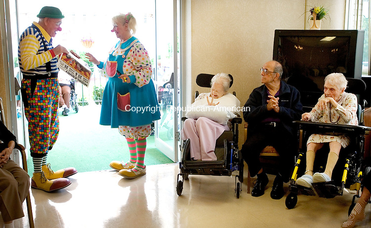 MIDDLEBURY CT. 17 June 2014-061714SV05-Blondi, Teresa Gretton, and Bunky, Bob Gretton, entertain residents at Middlebury Convalescent Home Rehabilitation Service in Middlebury Tuesday. The clowns are goodwill ambassador for the Cole Bros. Circus. The circus will be in Middlebury on the 25th and 26th of June. <br /> Steven Valenti Republican-American