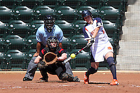 Netherlands catcher Nathalie Timmermans #26 bats in front of Rutgers catcher Kylee Bishop #21 and umpire Al Staniford during a game against Rutgers at the USF Bulls Softball Complex on March 14, 2012 in Tampa, Florida.  (Mike Janes/Four Seam Images)