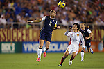 15 December 2012: Christie Rampone (USA) (3) and Ren Guixin (CHN) (23). The United States Women's National Team played the China Women's National Team at FAU Stadium in Boca Raton, Florida in a women's international friendly soccer match. The U.S. won the game 4-1.