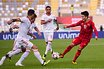 Nguyen Quang Hai of Vietnam (R) fights for the ball with palyers of Iran during the AFC Asian Cup UAE 2019 Group D match between Vietnam (VIE) and I.R. Iran (IRN) at Al Nahyan Stadium on 12 January 2019 in Abu Dhabi, United Arab Emirates. Photo by Marcio Rodrigo Machado / Power Sport Images