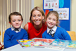 Caroline Cronin with her new junior infants Charlie O'Neill and Betti Baker in Kiltallagh NS Castlemaine on Wednesday