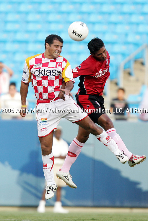 Diego Colotto (l) of Tecos and Hugo Ayala (r) of Atlas challenge for a header on Sunday, July 17, 2005, at Bank of America Stadium in Charlotte, North Carolina. U.A.G. Tecos defeated Atlas (both of the Mexican soccer league) 1-0 in a preseason game.