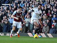 Pictured: David N'Gog of Swansea (R) against Stewart Downing of West Ham (L). 01 February 2014<br /> Re: Barclay's Premier League, West Ham United v Swansea City FC at Boleyn Ground, London.