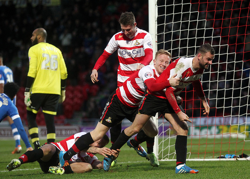 Doncaster Rovers' Richard Wellens (right) celebrates scoring his sides second goal with team-mate Mark Duffy (centre) <br /> Photo by Rich Linley/CameraSport<br /> <br /> Football - The Football League Sky Bet Championship - Doncaster Rovers v Wigan Athletic - Saturday 18th January 2014 - Keepmoat Stadium - Doncaster<br /> <br /> &copy; CameraSport - 43 Linden Ave. Countesthorpe. Leicester. England. LE8 5PG - Tel: +44 (0) 116 277 4147 - admin@camerasport.com - www.camerasport.com