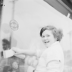 Female worker washing shop window, Finland 1960s