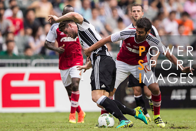 Juventus' player Lorenzo Rosseti battles South China's player Vieira Junior Luiz Carlos for the ball in action during the South China vs Juventus match of the AET International Challenge Cup on 30 July 2016 at Hong Kong Stadium, in Hong Kong, China.  Photo by Marcio Machado / Power Sport Images