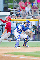 Burlington Royals catcher Chase Vallot (8) waits for the throw as Casey Turgeon (8) of the Johnson City Cardinals scores a run at Burlington Athletic Park on July 14, 2014 in Burlington, North Carolina.  The Cardinals defeated the Royals 9-4.  (Brian Westerholt/Four Seam Images)