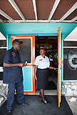 EXUMA, Bahamas. A local police woman at the Staniel Cay Yacht Club at Staniel Cay.