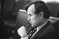 Central Intelligence Agency (CIA) Director George H.W. Bush listening intently during a meeting following the assassinations of Ambassador to Lebanon Francis E. Meloy, Jr. and Economic Counselor Robert O. Waring in Beirut, Lebanon. 17 June 1976