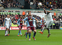 Sunday, 26 April 2014<br /> Pictured: Ashley Williams of Swansea (R) heads the ball over Ron Vlaar of Aston Villa (C)<br /> Re: Barclay's Premier League, Swansea City FC v Aston Villa at the Liberty Stadium, south Wales.