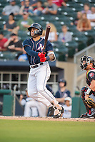 Northwest Arkansas Naturals infielder Emmanuel Rivera (26) connects on a pitch for a home run during a Texas League game between the Northwest Arkansas Naturals and the Arkansas Travelers on May 30, 2019 at Arvest Ballpark in Springdale, Arkansas. (Jason Ivester/Four Seam Images)