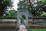 Hanoi, Vietnam, Three young friends walk through the gardens at Ngoc Son (Jade Mountain) Temple in Hoan Kiem Lake. photo taken July 2008.