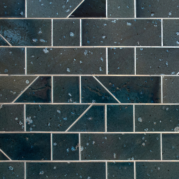 Quintin, a waterjet stone mosaic, shown in Orchid Basalto and Zinc liners, is part of the Bright Young Things™ collection by New Ravenna.