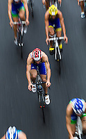 07 JUL 2012 - PARIS, FRA -  Aaron Harris (GT Vesoul Haute-Saone) (centre, #67, in blue with red and white helmet) cycles in a pack during the elite men's French Grand Prix round at the 2012 Triathlon de Paris around the Pont d'Lena, Paris, France .(PHOTO (C) 2012 NIGEL FARROW)