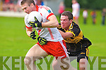 Currow's   tries to stop An Ghaeltacht Tomas O Se in the intermediate championship at Currow on Sunday.
