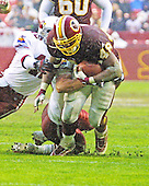 Washington Redskins running back Stephen Davis (48) carries the ball in fourth quarter action during the game against the Arizona Cardinals in Landover, Maryland on January 6, 2002. Cardinals defensive back Kwamie Lassiter (42) defends on the play. The Redskins won the game 20 - 17.<br /> Credit: Arnie Sachs / CNP