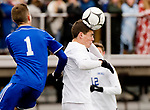 NEW BRITAIN, CT-111817JS12- Lewis Mills' Ryan Huydic (20) heads the ball in front of Suffield's Garrett Maxwell (1) during their Class M state final game Saturday at Willow Brook Park in New Britain.<br /> Jim Shannon Republican-American