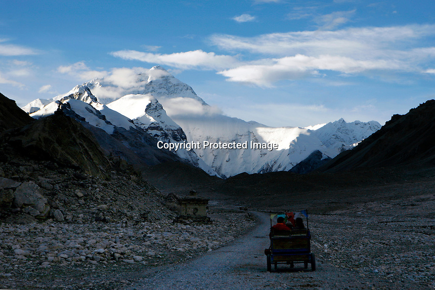"China started building a controversial 67-mile ""paved highway fenced with undulating guardrails"" to Mount Qomolangma, known in the west as Mount Everest, to help facilitate next year's Olympic Games torch relay./// Chinese tourists take a pony cart to Everest Base Camp.<br /> Tibet, China<br /> July, 2007"