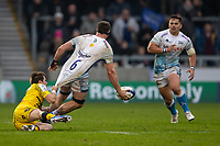 24th November 2019; AJ Bell Stadium, Salford, Lancashire, England; European Champions Cup Rugby, Sale Sharks versus La Rochelle; Ben Curry of Sale Sharks has his shirt pulled as he passes the ball to Rohan Janse van Rensburg of Sale Sharks - Editorial Use