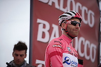 'maglia rosa' Svein Tuft (CAN/Orica-GreenEdge) on the start podium<br /> <br /> Giro d'Italia 2014<br /> stage 2: Belfast-Belfast <br /> 219km