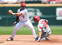 NWA Democrat-Gazette/CHARLIE KAIJO Arkansas infielder Carson Shaddy (20) slides to second as South Carolina infielder Justin Row (3) attempts a tag during the second game of the NCAA super regional baseball, Sunday, June 10, 2018 at Baum Stadium in Fayetteville. Arkansas fell to South Carolina 5-8.