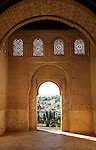 Stone arches in Islamic key shape in the Generalife palace, Alhambra, Granada, Spain