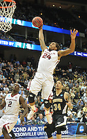 NWA Democrat-Gazette/Michael Woods --03/19/2015--w@NWAMICHAELW... University of Arkansas guard Michael Qualls goes up for a dunk in the second half of Thursday nights 56-53 win against the Wofford Terriers in the 2015 NCAA basketball tournament at Jacksonville Veterans Memorial Arena in Jacksonville, Florida.