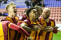 Substitute Tyrell Robinson of Bradford City celebrates  scoring a last minute winner with his team mates during the Sky Bet League 1 match between Wigan Athletic and Bradford City at the DW Stadium, Wigan, England on 18 November 2017. Photo by Thomas Gadd.