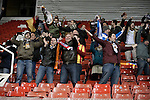 Stoke City 0 Valencia 1, 16/02/2012. Britannia Stadium, UEFA Europa League. The small band of around 60 visiting supporters react with delight as their team scores the only goal of the game at the Britannia Stadium, Stoke-on-Trent, during the UEFA Europa League last 32 first leg between Stoke City and visitors Valencia. The match ended in a 1-0 victory from the visitors from Spain. Mehmet Topal scored the only goal in the first half in a match watched by a crowd of 24,185. Photo by Colin McPherson.