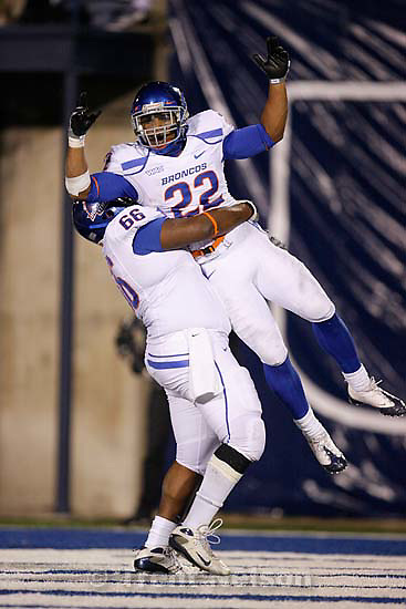 Boise State's Thomas Byrd lifts teammate Doug Martin after Martin scored, giving Boise State a 35-14 point lead over Utah State at the end of the first half. Utah State vs. Boise State college football Friday, November 20 2009.