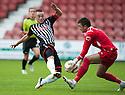 Stranraer keeper David Mitchell saves at the feet of Pars' Ryan Wallace.