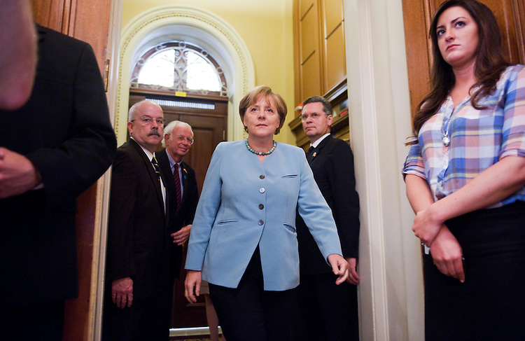 UNITED STATES - JUNE 07:  German Chancellor Angela Merkel, arrives for a photo op conducted with Senate Majority Leader Harry Reid, D-Nev., and other senator before a lunch in the Capitol. (Photo By Tom Williams/Roll Call)