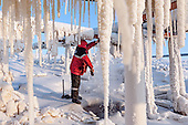A LUKoil worker repairs a leaking pipe in the Komi Region in the Russian Arctic, home to some of the world's largest natural gas deposits.