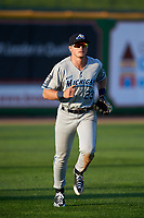 West Michigan Whitecaps left fielder Cam Gibson (23) jogs back to the dugout during a game against the Peoria Chiefs on May 8, 2017 at Dozer Park in Peoria, Illinois.  West Michigan defeated Peoria 7-2.  (Mike Janes/Four Seam Images)