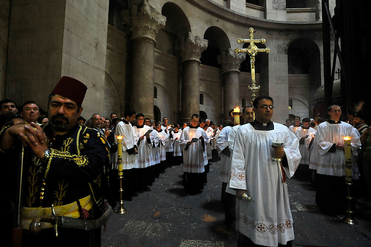 Catholic priests on a procession during an Easter Mass at the Church of the Holy Sepulchre in Jerusalem.