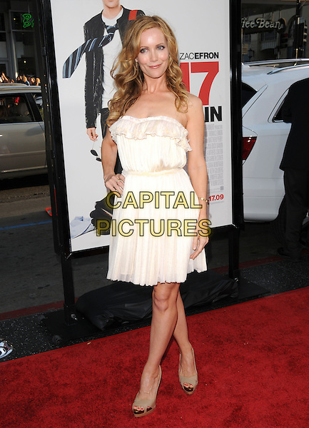 "LESLIE MANN .The L.A. premiere of ""17 Again"" held at The Grauman's Chinese Theatre in Hollywood, California, USA. .April 14th, 2009.full length white cream dress hand on hip ruffle beige open toe shoes .CAP/DVS.©Debbie VanStory/Capital Pictures."