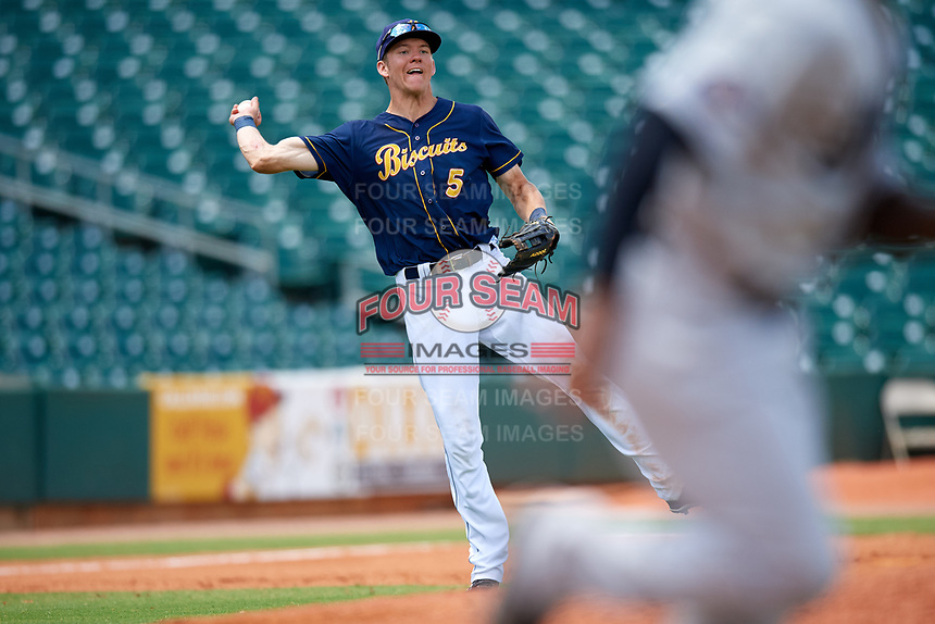 Montgomery Biscuits third baseman Michael Russell (5) throws to first base during a game against the Biloxi Shuckers on May 8, 2018 at Montgomery Riverwalk Stadium in Montgomery, Alabama.  Montgomery defeated Biloxi 10-5.  (Mike Janes/Four Seam Images)