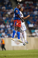 Haiti defender Mechak Jerome (3) goes up for a header with Honduras midfielder Rony Martinez (11). during a CONCACAF Gold Cup group B match at Red Bull Arena in Harrison, NJ, on July 8, 2013.