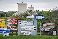 County Clare, Ireland:<br /> Collection of road signs on a Doolin village street