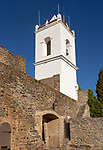 Whitewashed tower and gateway to historic walled hilltop village of Monsaraz, Alto Alentejo, Portugal, southern Europe