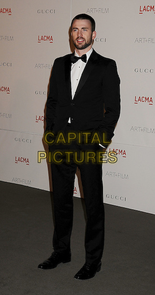 Chris Evans.The Inaugural Art and Film Gala held at LACMA in Los Angeles, California, USA..November 5th, 2011.full length tuxedo hands in pockets black white bow tie beard facial hair .CAP/ROT/TM.©Tony Michaels/Roth Stock/Capital Pictures