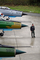 MiG-21 F pilot ?? of the 95th Air Force Base from the Romanian Air Force. BOLD AVENGER 2007 (BAR 07), a NATO  air exercise at Ørland Main Air Station, Norway. BAR 07 involved air forces from 13 NATO member nations: Belgium, Canada, the Czech Republic, France, Germany, Greece, Norway, Poland, Romania, Spain, Turkey, the United Kingdom and the United States of America..The exercise was designed to provide training for units in tactical air operations, involving over 100 aircraft, including combat, tanker and airborne early warning aircraft and about 1,450 personnel.