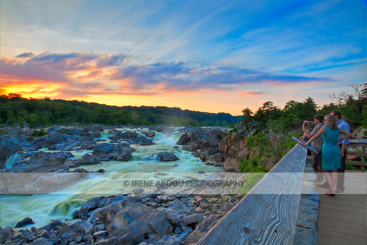 Visitors watch a glorious summer sunset over Great Falls in Potomac, Maryland.