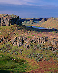 Columbia National Wildlife Refuge, WA<br /> Morning light on basalt cliffs and grasslands at Katy Lake, Drumheller Channels, Channels National Natural Landmark