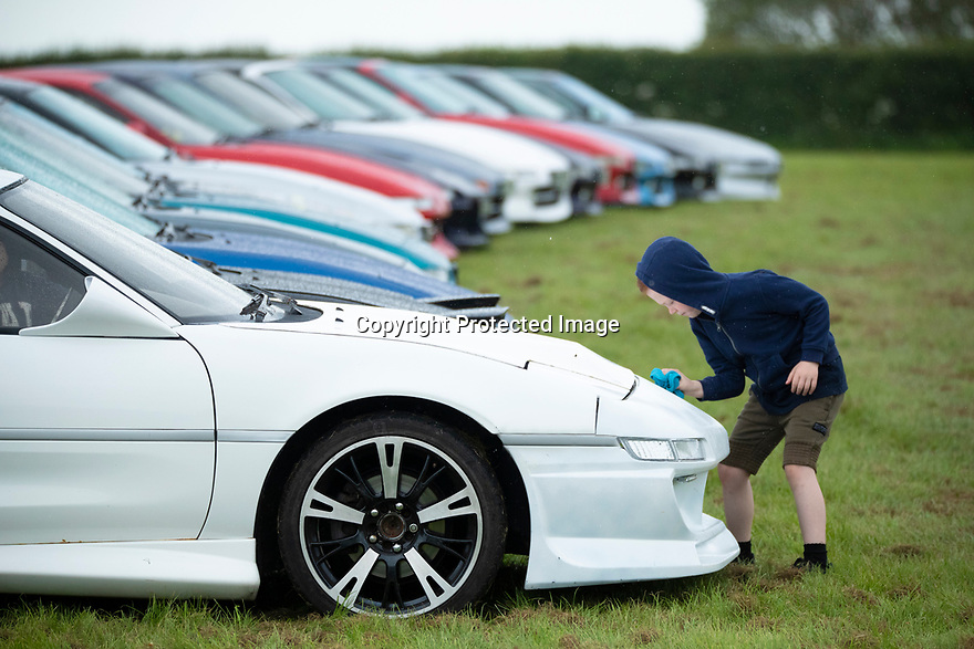 02/05/15<br /> <br /> Ryan Foames, 5, wipes the rain from his dad's MR2 at the Toyota marque's day at Hatton Country World, Warwickshire.<br /> <br /> All Rights Reserved: F Stop Press Ltd. +44(0)1335 418365   +44 (0)7765 242650 www.fstoppress.com