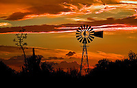 A windmill on the outskirts of Oro Valley, Arizona during a brilliant sunset.