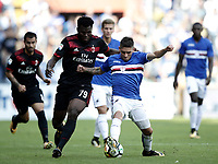 Calcio, Serie A: Genova, Stadio Luigi Ferraris, 24 settembre 2017. <br /> Sampdoria's Lucas Torreira (r) in action with Milan's Frank Kessie (l) during the Italian Serie A football match between Sampdoria and Milan at Genova's Luigi Ferraris stadium. September 24, 2017.<br /> UPDATE IMAGES PRESS/Isabella Bonotto